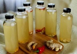 nutritious-fermentation-bottles-on-kitchen-counter-with-jerusalem-artichoke