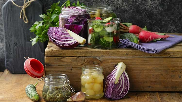 fermenting-fragrant-vegetables-in-jars-with-cabbage-radishes-cucumbers